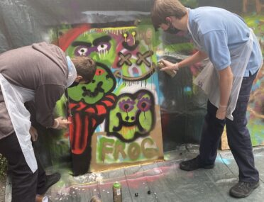 Burst of colour as students embrace spray painting workshops cover image